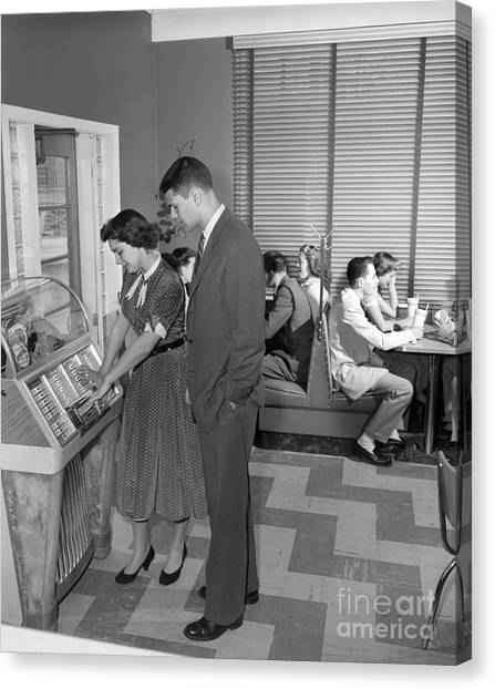 Jukebox Canvas Print - Teen Couple Playing Jukebox, C. 1950s by H. Armstrong Roberts/ClassicStock