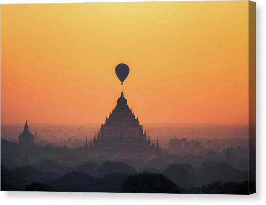 temples in Bagan with hot air balloon for traval on sun rise and Canvas Print by Anek Suwannaphoom