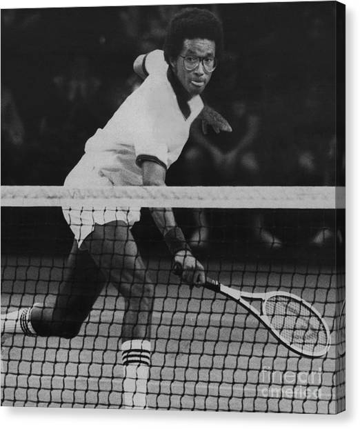 Tennis Great, Arthur Ashe, Returns The Ball At The Atp Worls Tour Finals In 1979. Canvas Print by Bob Olen