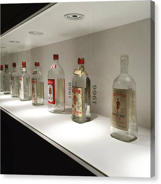 Gin Canvas Print - The Beefeater Bottle Evolution. #london by Andres Contreras
