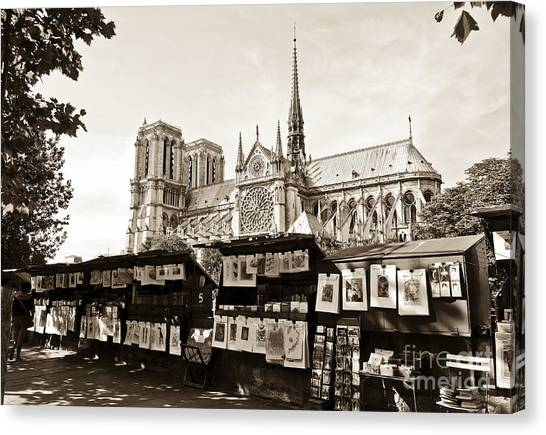 The Bouquinistes And Notre-dame Cathedral Canvas Print