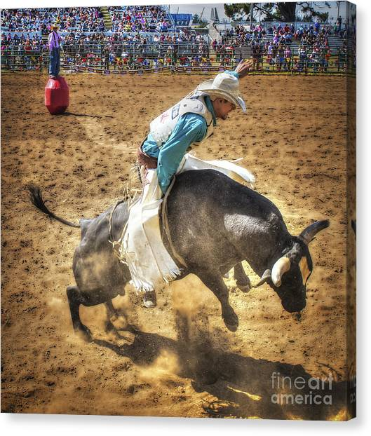 Rodeo Clown Canvas Print - The Bull And The Clown by Christopher Cutter