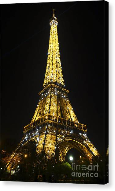 The Eiffel Tower At Night Illuminated, Paris, France. Canvas Print