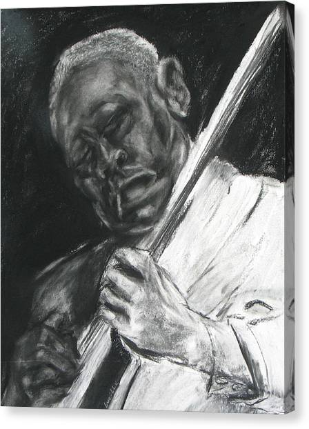 The Guitar Player Canvas Print by Patrick Mills