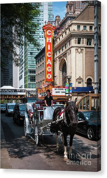 The Iconic Chicago Theater Sign And Traffic On State Street Canvas Print