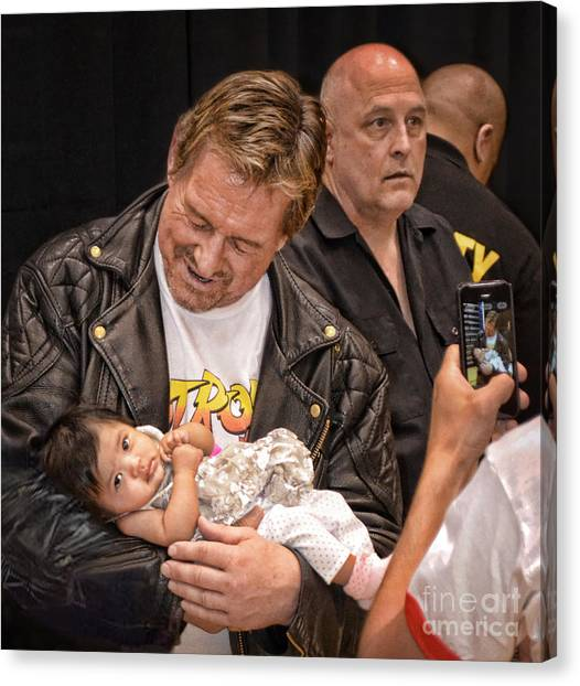 Hulk Hogan Canvas Print - The Late Pro Wrestling Legend Roddy Piper Sharing A Special Moment With His Youngest Fan by Jim Fitzpatrick