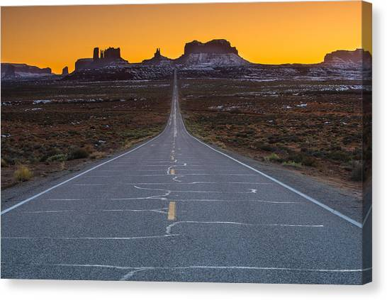 Singh Canvas Print - The Long Road To Monument Valley by Larry Marshall