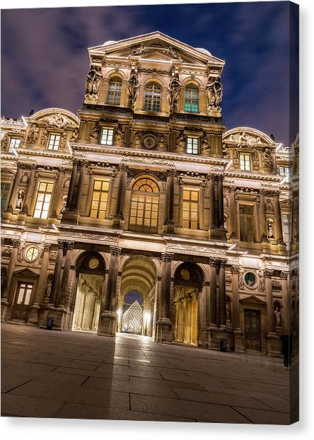 Louvre Canvas Print - The Louvre Museum At Night by James Udall