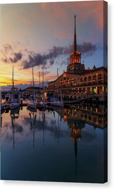 the nautical station and the yacht on the main sea channel of the Sochi seaport Canvas Print