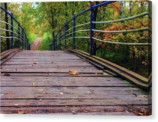 the old bridge over the river invites for a leisurely stroll in the autumn Park Canvas Print