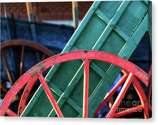 The Red Wagon Wheel Canvas Print