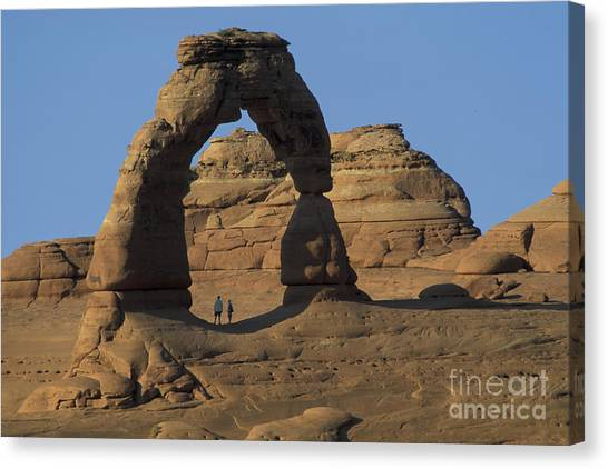 The Scale Of Delicate Arch Canvas Print by Stan and Anne Foster