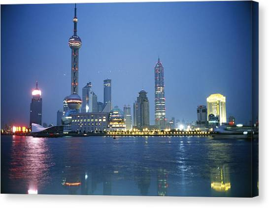 Shanghai Skyline Canvas Print - The Shanghai Skyline And Riverfront by Raul Touzon