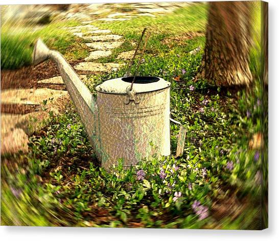 The Watering Can Canvas Print