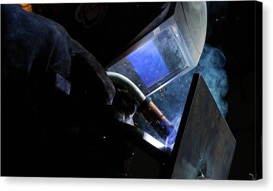 The Welder Canvas Print