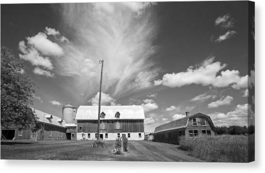 Three Barns With Clouds On Clark Lakes Road Canvas Print by Stephen Mack