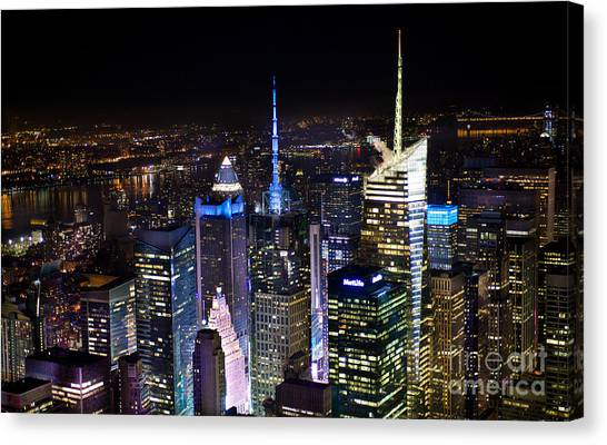 Times Square After Dark Canvas Print by Ken Andersen