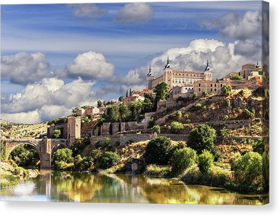 Toledo. Majestic Stone Fortress The Alcazar Is Visible From Any Part Of The City Canvas Print