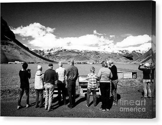 Eyjafjallajokull Canvas Print - Tourists At The Thorvaldseyri Family Farm Beneath Eyjafjallajokull Glacier And Volcano Iceland by Joe Fox