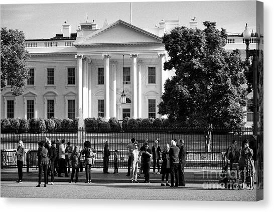 Whitehouse Canvas Print - tourists outside the north facade from pennsylvania avenue the white house Washington DC USA by Joe Fox