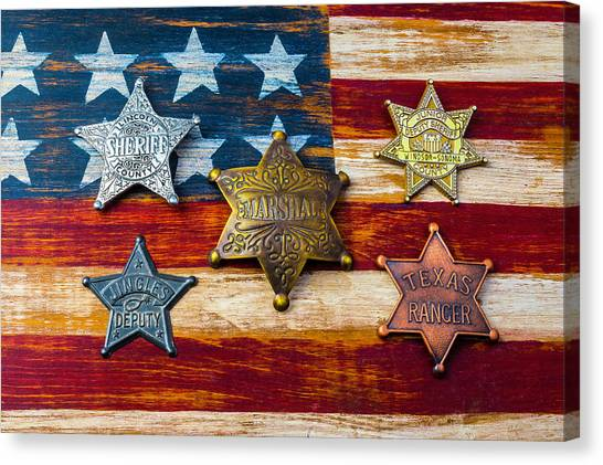 Texas Rangers Canvas Print - Toy Badges On America Flag by Garry Gay