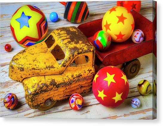 Dump Trucks Canvas Print - Toy Truck With Balls And Marbles by Garry Gay