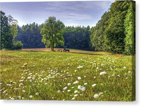Tractor In Field With Flowers Canvas Print