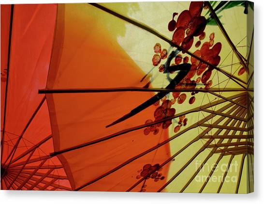 Traditional Red And Yellow Umbrellas Canvas Print by Sami Sarkis
