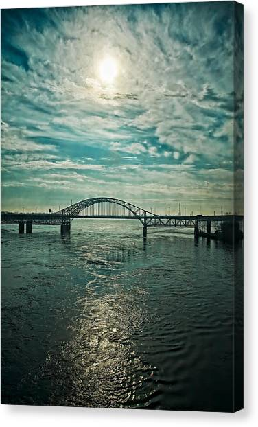 Traffic On The Bridge Canvas Print by Michel Filion