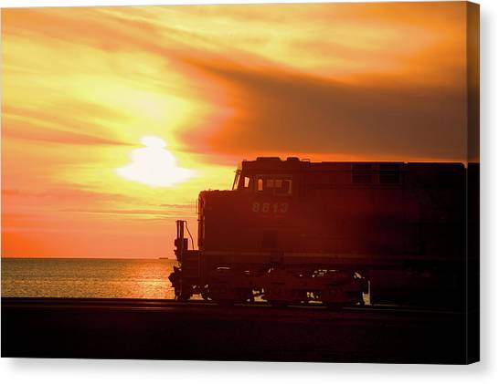 Train And Sunset Canvas Print by Paul Kloschinsky