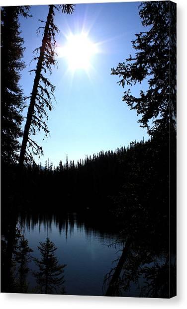 Tree-framed Lake Canvas Print by Joseph Peterson