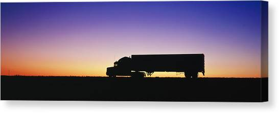 Roads Canvas Print - Truck Parked On Freeway At Sunrise by Jeremy Woodhouse