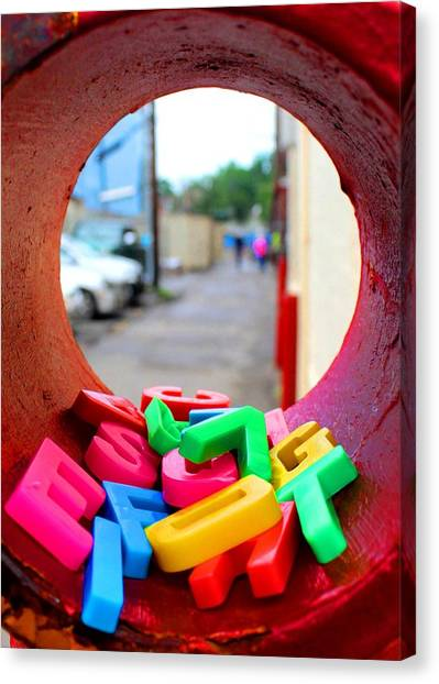 Tube Of Jumbled Letters Canvas Print