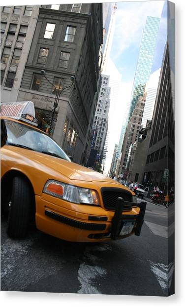 Turning Taxi Canvas Print by Jeff Porter