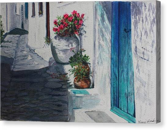 Turquoise Door Canvas Print by Yvonne Ayoub