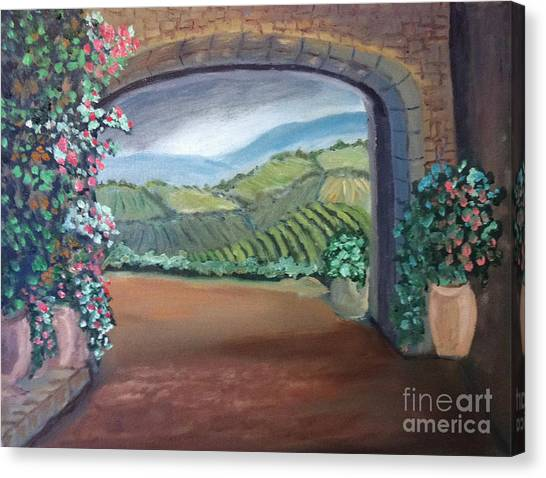 Tuscany Vineyards Through The Archway Canvas Print