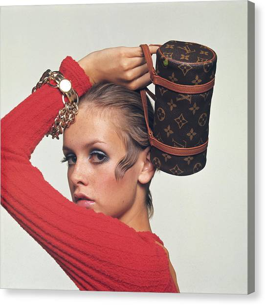 Twiggy With Louis Vuitton Purse Canvas Print by Bert Stern