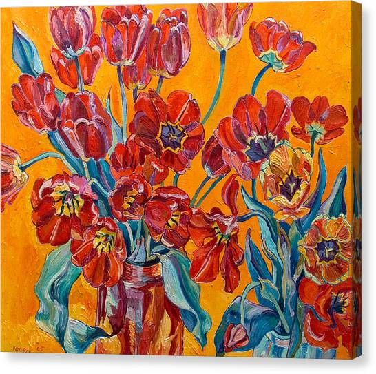 Two Bunches Of Red Tulips Canvas Print by Vitali Komarov