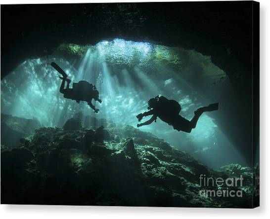 Spelunking Canvas Print - Two Divers Silhouetted In Light by Karen Doody
