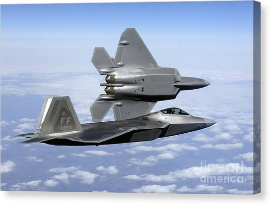 Canvas Print featuring the photograph Two F-22a Raptors In Flight by Stocktrek Images