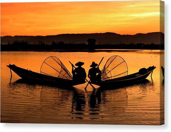 Canvas Print featuring the photograph Two Fisherman At Sunset by Pradeep Raja Prints