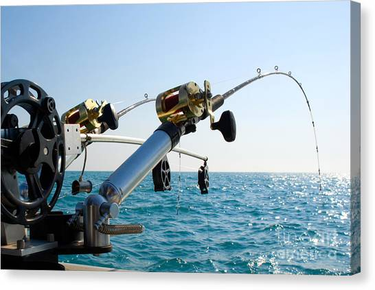 Angling Canvas Print - Two Fishing Poles On Back Of Boat by Paul Velgos
