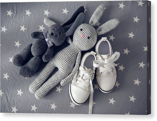 4558c0c91687b0 Shoe Lace Canvas Print - Two Grey Knitted Toy Rabbit And Children s White  Shoes by Elena