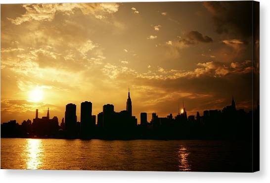City Sunsets Canvas Print - Two Suns - The New York City Skyline In Silhouette At Sunset by Vivienne Gucwa