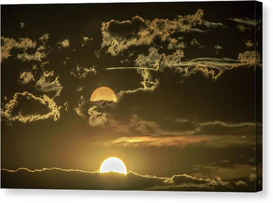 Two Suns Setting Canvas Print