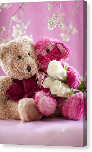 Two Teddy Bears With Roses Canvas Print