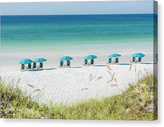 Umbrellas Await On The Beach Canvas Print