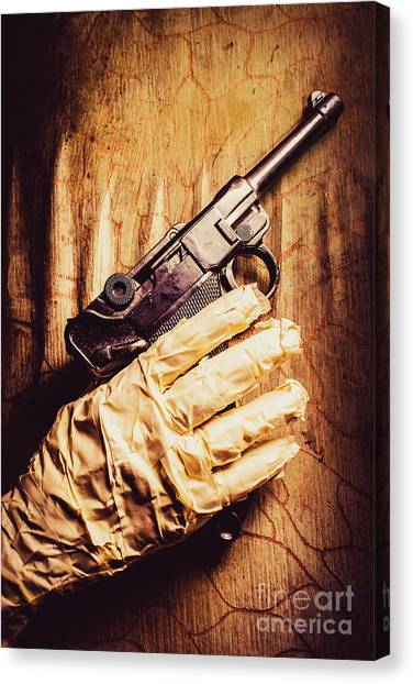 Gloves Canvas Print - Undead Mummy  Holding Handgun Against Wooden Wall by Jorgo Photography - Wall Art Gallery