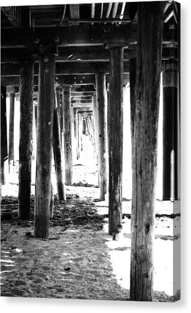 Sand Canvas Print - Under The Pier by Linda Woods