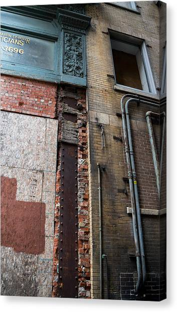 Urban Reconstruction Canvas Print by Denise McKay